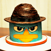 Perry The Platypus The Face Was A Butter Cream Transfer And The Hat Was Chocolate Covered Rice Crispy Treat   Perry the platypus the face was a butter cream transfer and the hat was chocolate covered rice crispy treat