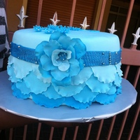 Ruffles Cake With Flower Ruffled skirt with glitter belt and flower. I did this for my cousins daughter, I took inspiration from a few cakes here and this is what I...