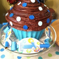 "Giant Cupcake 1st Birthday cake for my grandson using the Wilton giant cupcake pan. The ""cupcake liner"" was made with candy melts and the..."