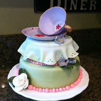 Tea Time Fondant covered. Flowers and tea cup made with gum paste