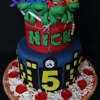Teenage Mutant Ninja Turtles This cake was made for a friend's son. They are the owners of a local Pizza Shop. They came to me with a picture of a cake that...