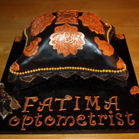 Hand Carved Pillow Cake Finished In Black Satin Fondant With Eastern Inspired Ornaments