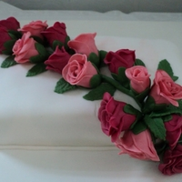 Cake With Roses White fondant covered with hand made gum paste roses