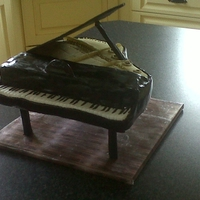 Grand Piano Cake Sadly this cake suffered a mishap when it slipped off the cake board, hence it being a bit out of shape!