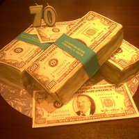 Dollar Birthday Cake 70th Birthday cake I made for my father in law. Piles of dollars made from Chocolate cake covered in fondant and printable icing.