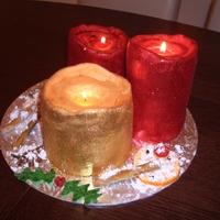 Christmas Candles Christmas candles made with fruit cake and surrounded by fondant decorations