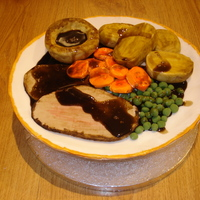 Roast Beef With All The Trimmings Roast dinner set on fondant icing plate.