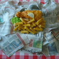 Fish And Chips Traditional British fish and chips served in newspaper. 100% edible made with orange sponge, buttercream and fondant along with the use of...