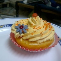 Mango Cupcake With Pistachio Mousse Filling Mango cake with pistachio mousse n whipped mango cream as frosting
