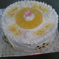 Pineapple Cake One of my first few attempts at baking a cake....its a pineapple cake with strawberry n pineapple cream filling n whipped cream as icing