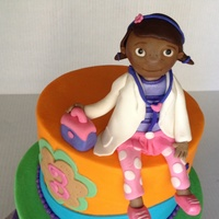 Doc Mcstuffins Fondant And Gum Paste Figures Cake Covered With Colorful Buttercream With Fondant Decorations   Doc Mcstuffins fondant and gum paste figures cake covered with colorful buttercream with fondant decorations