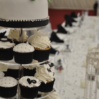 Black And White Wedding Cake   Black and white wedding cupcakes, with chocolate mud top tier cake with handmade sugar roses and calia lilies with diamonte