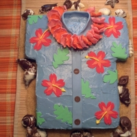 "Hawaiian Shirt Hawaiian shirt with cream cheese icing and fondant decorations. ""Sand"" is raw sugar and shells are made from chocolate."