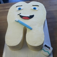 Tooth Cake   Made for a graduate of dental school. Buttercream with fondant accents.