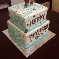Happy Fathers Day 2 tier whipped cream covered cake...with fondant decoration