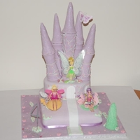 Fairy Castle Cake Fair Castle Cake - All edible (except for the dolls) including turrettes which, I made rows of holes in and placed battery operated tea...