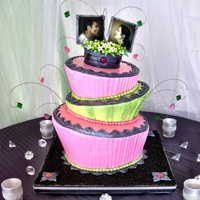 Bejeweled Topsy-Turvy Wedding Cake Topsy-turvy wedding cake with edible photo topper and candy jewels made from Isomalt; built with layers of chocolate, vanilla and fresh...