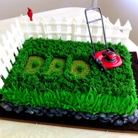 Father's Day Lawn Mower Cake. Fresh strawberry cake with fondant & buttercream grass, gumpaste lawn mower & fence, fondant cardinal & rocks, with Oreo crumb...