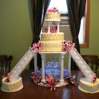 Stargazer Lilly Cake  This was my first wedding cake using the pillars and fountain and stairs. It was vanilla and chocolate cakes with buttercream filling and...