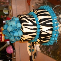 "Zebra Stripe Birthday Cake   8"" and a 6"" round chocolate peanutbutter cake with buttercream and fondant decorations."