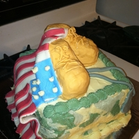 "Deployment Cake   vanilla 8"" square cake with buttercream icing and fondant decorations. Boots are rice krispy covered in fondant"