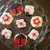 Ladybug Baby Shower   Vanilla cupcakes with ladybug and daisy flower fondant toppers