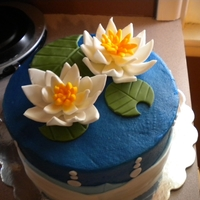 "Water Lilly Engagement Cake   8"" funfetti cake with buttercream filling. Buttercream icing with fondant decorations and fondant waterlilly."
