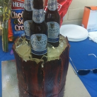 Sugar Beer Bottle Cake The bottles and ice are made from sugar and the barrel is made from fondant brushed with food coloring. The labels are not edible. They are...