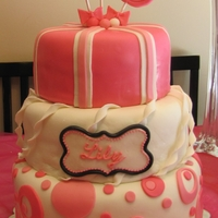 Lollipop Cake Cake is covered with MMF. Decorated with circles, strips, twists and lollipops.