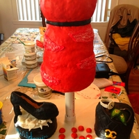 Fashion Cake my first sculpted cake for my best friend's 19th birthdaythe body is a vanilla cake with strawberry pureethe two smaller cakes are red...