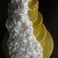 Gold Cake With White Ruffles Gold cake with white ruffles.