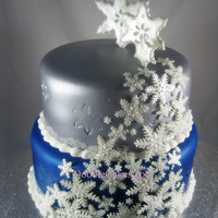 Sliver And Blue Snowflake Cakes   Sliver and blue snowflake cakes.