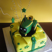 John Deere John Deere tractor cake topper for someone who loves to farm. Open vanilla cake gift box