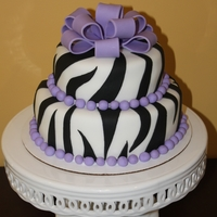 Zebra Birthday Cake 2 tier vanilla and chocolate zebra cake.