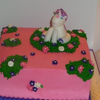 Unicorn Birthday Cake Fondant Unicorn Topper, Cake was colored pink and purple inside and frosted and decorated in buttercream.