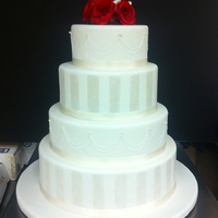 4 Tier Round Wedding Cake Topped With Gum Paste Roses 4 tier round wedding cake topped with gum paste roses