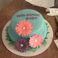 Spring Baby Shower Fondant covered cake with gum paste gerber daisies