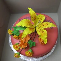 Birthday With Tiger Lily And Flower Spray Fondant covered cake with gumpaste tiger lily, poppies and sweet peas