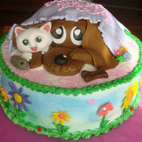 Dog And Kitty Flower Birthday Cake 12 inch cake- Vanilla with PB filling--- Chocolate Cake Dog and all of it is frosted with homemade buttercream.