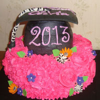 Bright Fun Graduation Cap Cake Front of Big bright graduation cake