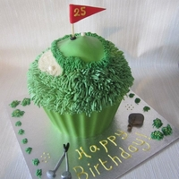 Giant Golf Themed Cupcake! I made this for a 25th birthday. Despite appearances it was actually lemon flavour with lemon filling! The recipient of the cake plays Golf...