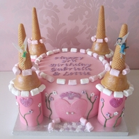 Pink Castle Cake  This cake was for a joint 3rd birthday party, I was asked to do something pink, girly and sparkly, and they like fairies. I came up with...
