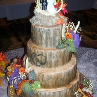 Rustic Wedding Cake Purple peony's are gumpaste. Tree bark is made from a mold and airbrushed