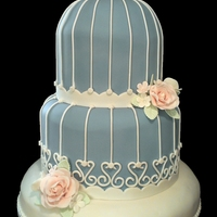 Bird Cage Wedding Cake This is my second ever wedding cake. The bride chose a bird cage shape. She didnt want any royal icing so it was all made with fondant.