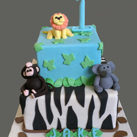 Jungle Theme A first birthday cake with his favorite animals. My first effor at a monkey and lion