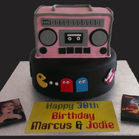 80's Theme Cake Boom box, Pac Man, Ghost Busters, Back to the Future, Madonna, Care Bears and Rubiks cube, you cant get more 80's