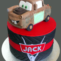 Tow Mater Tow Mater from Cars. The cake was a 6 layer rainbow cake made to look like tyres on the outside