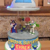 Toy Story Alien Ufo Invasion Spinning Musical Carousel Birthday Cake   My Son's cake for his 2nd Birthday. It spins and plays music like a carousel music box.