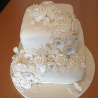 Ivory Wedding Cake With Flower And Butterfly Cascade