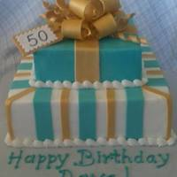 Turquoise And Gold 50Th Birthday Cake Butter Cream Icing With Fondant Stripes And Bow Turquoise and gold 50th birthday cake. Butter cream icing with fondant stripes and bow.
